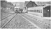 View of RGS section house and passenger car depot at Vance Junction.  A Goose stands beside the section house.<br /> RGS  Vance Junction, CO