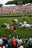 USA, Tennessee, Nashville, Iroquois Steeplechase, Jockeys and their horses pass under the wire during the second race of the day