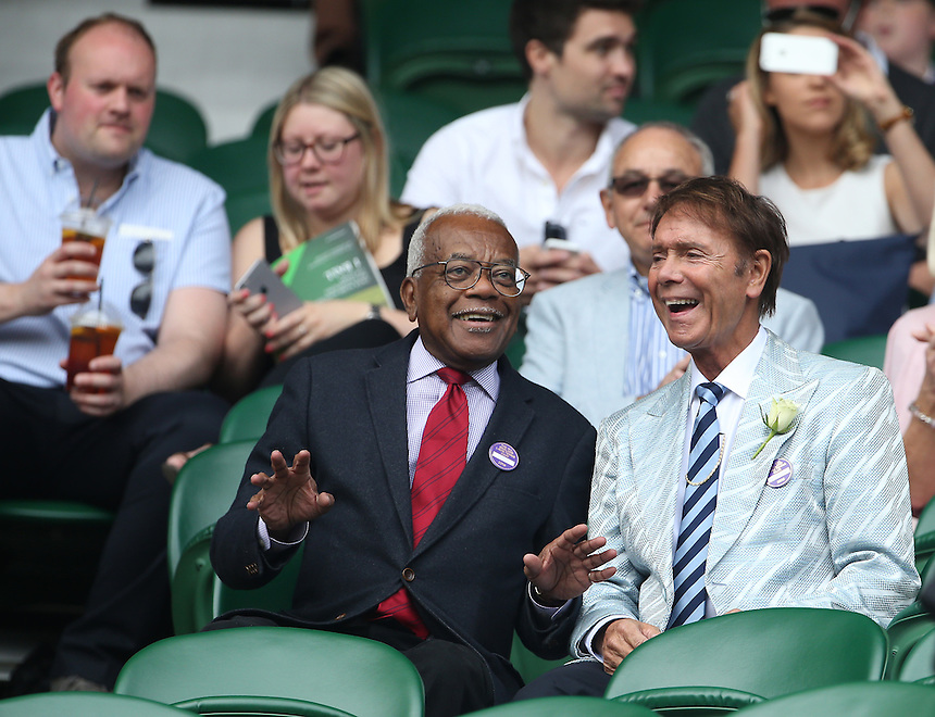 Cliff Richard and Sir Trevor McDonald, OBE enjoy the tennis from the members enclosure<br /> <br /> Photographer Stephen White/CameraSport<br /> <br /> Tennis - Wimbledon Lawn Tennis Championships - Day 2 - Tuesday 28th June 2016 -  All England Lawn Tennis and Croquet Club - Wimbledon - London - England<br /> <br /> World Copyright &copy; 2016 CameraSport. All rights reserved. 43 Linden Ave. Countesthorpe. Leicester. England. LE8 5PG - Tel: +44 (0) 116 277 4147 - admin@camerasport.com - www.camerasport.com