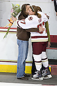 Brett Hart, Julie Hart, Laura Hart (BC - 27) - The Boston College Eagles and the visiting University of New Hampshire Wildcats played to a scoreless tie in BC's senior game on Saturday, February 19, 2011, at Conte Forum in Chestnut Hill, Massachusetts.