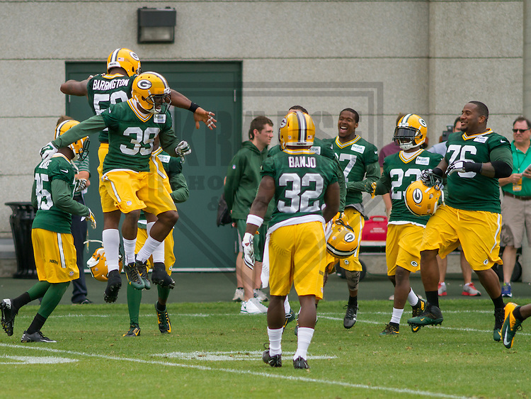 GREEN BAY - June 2015: Green Bay Packers cornerback Demetri Goodson (39) celebrates an interception with teammates during a minicamp practice on June 18th, 2015 at Clarke Hinkle Field in Green Bay, Wisconsin. (Brad Krause/Krause Sports Photography)
