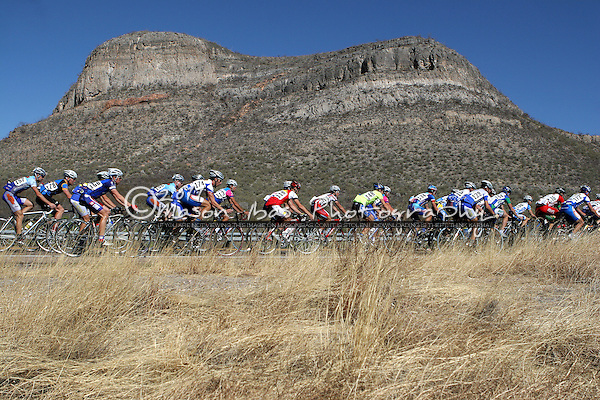 The pro peloton passes the signs of an ancient sea bed during the 28th La Vuelta de Bisbee Stage Race held in southeastern Arizona.