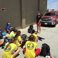 The Boys & Girls Club Swimming Pool, Clairemont, San Diego CA, USA.  June 26 2015:  San Diego Junior Lifeguards get a introduction to  the work of the San Diego Lifeguard Dive Team by Lifeguard Brittany Rowe.SCUBA.  More than 100 San Diego Junior Lifeguards particiapted in a PADI Discover Scuba Diving Program hosted by the San Diego Junior Lifeguard Foundation.  Instrurctors from Ocean Enterprises took the students through an introductory course in SCUBA.