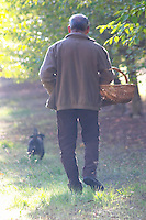 Hugues Martin, the owner of the truffles farm, with the truffles hunting sniffing dog called Mocha Truffiere de la Bergerie (Truffière) truffles farm Ste Foy de Longas Dordogne France