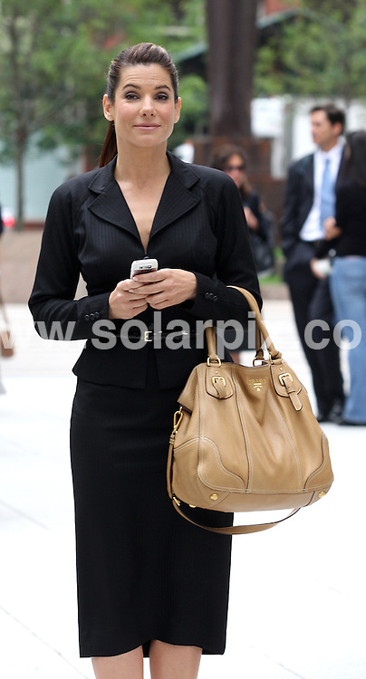 **ALL ROUND PICTURES FROM SOLARPIX.COM**.**SYNDICATION RIGHTS FOR UK, SPAIN, PORTUGAL, AUSTRALIA, S.AFRICA & DUBAI (U.A.E) ONLY**.Hollywood actress Sandra Bullock and Ryan Reynolds on the The Proposal Movie Set in Lower Manhattan 26 Federal Plaza in New York  in the USA.  .This Pic:Sandra Bullock..JOB REF:6580-PHZ/Janet Mayer    DATE:06_06_08 .**MUST CREDIT SOLARPIX.COM OR DOUBLE FEE WILL BE CHARGED* *UNDER NO CIRCUMSTANCES IS THIS IMAGE TO BE REPRODUCED FOR ANY ONLINE EDITION WITHOUT PRIOR PERMISSION*