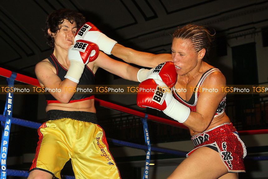 Laura Saperstein (red shorts) defeats Borislava Goranova in a Super-Featherweight boxing contest at York Hall, Bethnal Green, promoted by Left Jab / Miranda Carter - 20/06/10 - MANDATORY CREDIT: Gavin Ellis/TGSPHOTO - Self billing applies where appropriate - Tel: 0845 094 6026
