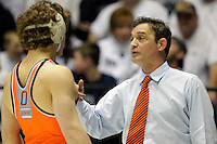 STATE COLLEGE, PA - FEBRUARY 16: Head coach John Smith of the Oklahoma State Cowboys during a match against the Penn State Nittany Lions on February 16, 2014 at Rec Hall on the campus of Penn State University in State College, Pennsylvania. Penn State won 23-12. (Photo by Hunter Martin/Getty Images) *** Local Caption *** John Smith