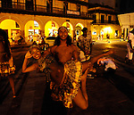 Street theater in a cobble stone inside the walled city of Old Cartagena.  Local dancers from a local, poor neighborhood perform artfully and energetically in the square.