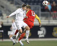 Amy LePeilbet #6 of the USA WNT heads past Jun Ma #13 of the PRC WNT during an international friendly match at PPL Park, on October 6 2010 in Chester, PA. The game ended in a 1-1 tie.