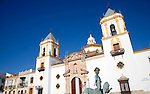 Church and sculpture of man with two lions, Plaza del Socorro, Ronda, Spain