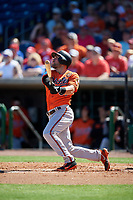 Baltimore Orioles catcher Austin Wynns (61) follows through on a swing during a Grapefruit League Spring Training game against the Philadelphia Phillies on February 28, 2019 at Spectrum Field in Clearwater, Florida.  Orioles tied the Phillies 5-5.  (Mike Janes/Four Seam Images)