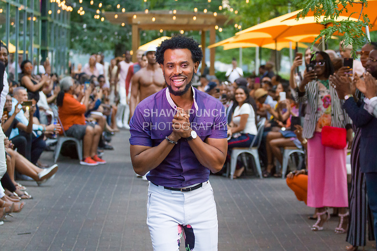 "Fashion designer Edwing D'Angelo thanks audience for attending his Edwing D'Angelo Spring Summer 2019 ""Pristine"" collection fashion show at Sofrito in New York City on July 11, 2018; during New York Fashion Week: Men's Spring Summer 2019."