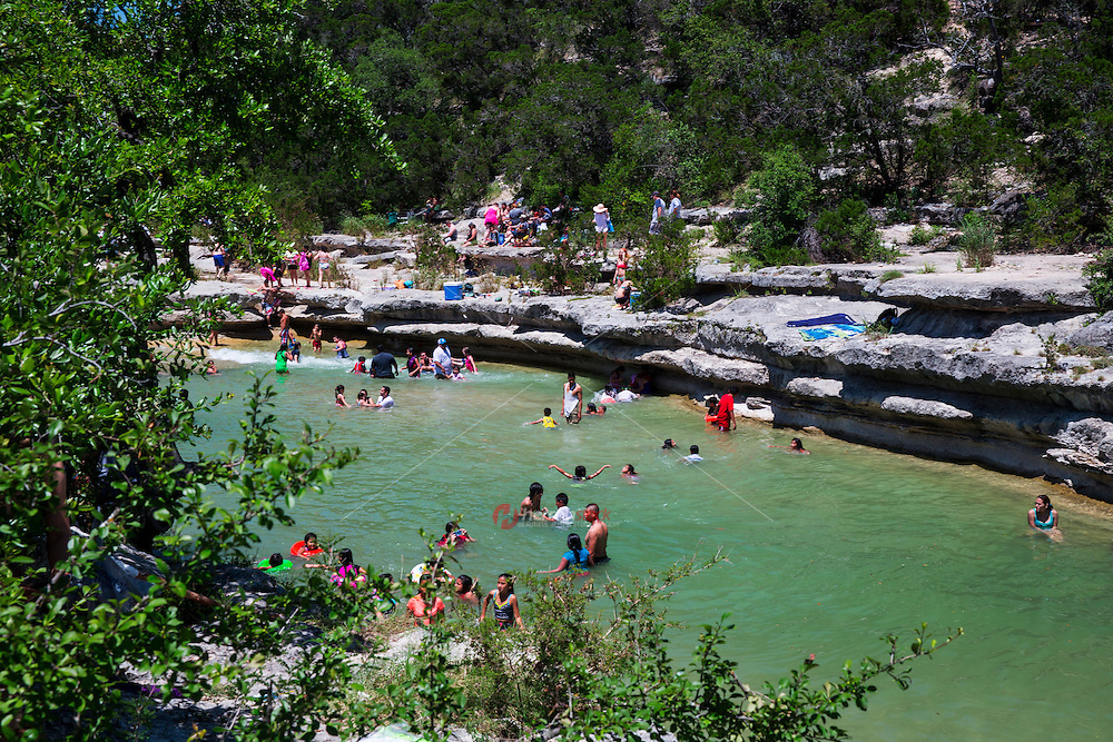 Bull Creek District Park is one of the tributaries that feed the Texas Colorado River from the Texas Hill Country. The creek passes through some of the more scenic areas in the Austin region and forms a greenbelt and swimming hole - Stock Image
