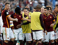 Calcio, Serie A: Roma vs Lazio. Roma, stadio Olimpico, 8 novembre 2015.<br /> Roma's Gervinho, second from left, celebrates with teammates after scoring during the Italian Serie A football match between Roma and Lazio at Rome's Olympic stadium, 8 November 2015.<br /> UPDATE IMAGES PRESS/Isabella Bonotto