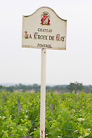 A white sign in the vineyards saying Chateau La Croix de Gay Pomerol Bordeaux Gironde Aquitaine France