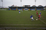 Port Talbot Town 3 Caerau Ely 0, 06/02/2016. Genquip Stadium, Welsh Cup fourth round. Early first-half action as Port Talbot Town (in blue) play host to Caerau Ely in a Welsh Cup fourth round tie at the Genquip Stadium, formerly known as Victoria Road. Formed by exiled Scots in 1901 as Port Talbot Athletic, they competed in local and regional football before being promoted to the League of Wales  in 2000 and changing their name to the current version a year later. Town won this tie 3-0 against their opponents from the Welsh League, one level below the welsh Premier League where Port Talbot competed, watched by a crowd of 113. Photo by Colin McPherson.