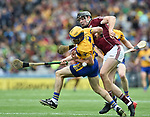 Seadna Morey of Clare in action against Joseph Cooney of Galway during their All-Ireland semi-final at Croke Park. Photograph by John Kelly.