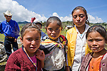 Four girls pose near a church in San Nicolas, Western Highlands, Guatemala
