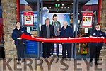 Rosie Hichey and Katie Ellard hold the ribbon as Jack Barry and Paddy Pendergast with Corrib Oil owner Eugene Dalton as they cut the ribbon at the official opening of the new Corrib Oil store on John Joe Sheehy Road on Friday.