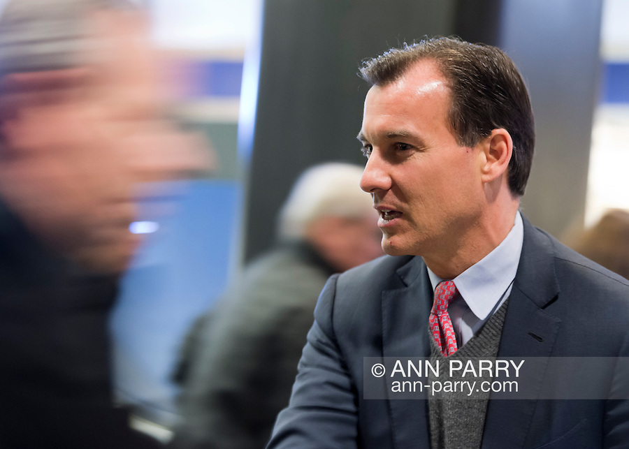 Manhattan, New York, U.S. 4th November 2013. TOM SUOZZI, Democratic candidate for Nassau County Executive, (R) meets potential voters during his campaign stop at Penn Station, near end of 36 straight hours of barnstorming across Nassau County, leading up to the November 5 general election. Former Nassau County Executive Suozzi and incumbent Republican Mangano are once again facing each other as challengers.