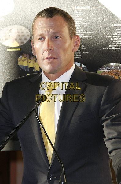 LANCE ARMSTRONG.Armstrong's first LIVESTRONG Day spent in Nevada to raise awareness for the fight against cancer held at the Nevada Cancer Institute, Las Vegas, Nevada, USA..May 13th, 2008.half length black suit jacket yellow tie microphone .CAP/ADM/MJT.© MJT/AdMedia/Capital Pictures.
