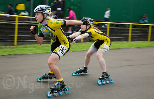11 AUG 2013 - BIRMINGHAM, GBR - Kirsty Pullen (left) of Birmingham Wheels Roller Speed Club is propelled forward at the changeover by team mate Toffany James  (right) during the Junior and Senior Women's 3000m Relay at the Federation of Inline Speed Skating 2013 British Outdoor Championships at Birmingham Wheels Park in Birmingham, West Midlands, Great Britain (PHOTO COPYRIGHT © 2013 NIGEL FARROW, ALL RIGHTS RESERVED)