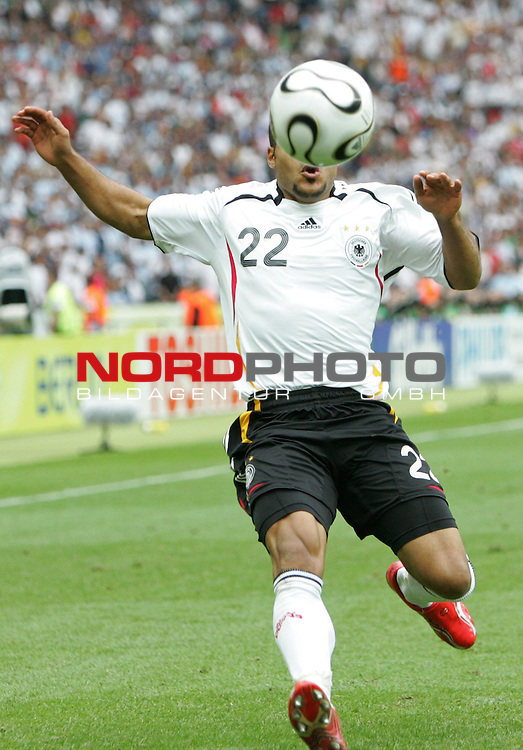FIFA WM 2006 - Quarter-finals / Viertelfinale<br /> Play #57 (30-Jun) - Germany vs Argentina.<br /> David Odonkor from Germany faces the ball during the match of the World Cup in Berlin.<br /> Foto &copy; nordphoto