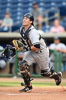 Tampa Yankees catcher Trent Garrison (11) chases down a pop up during a game against the Clearwater Threshers on June 26, 2014 at Bright House Field in Clearwater, Florida.  Clearwater defeated Tampa 4-3.  (Mike Janes/Four Seam Images)