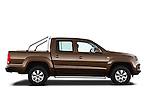 Passenger side profile view of a 2012 Volkswagen Amarok Trendline Truck .
