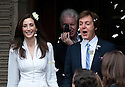 Paul McCartney wedding to Nancy Shevell at Westminster Registry Office in Marylebone Road, London.today 9.10.11.Happy couple leave with best man Mike, Paul's brother, taking a snap from behind them...Pic by Gavin Rodgers/Pixel 8000 Ltd
