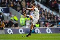 Owen Farrell of England converts his own try during the QBE Autumn International match for the Cook Cup between England and Australia at Twickenham on Saturday 2nd November 2013 (Photo by Rob Munro)