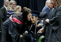NWA Democrat-Gazette/DAVID GOTTSCHALK  Eduardo Dominguez (cq), the first student to receive a diploma Friday, May 19, 2017, during commencement exercises for Rogers Heritage High School, is greeted by Karen Steen, the principal, on stage at Bud Walton Arena on the campus of the University of Arkansas in Fayetteville. There are 437 graduates from the Rogers Heritage High School class of 2017. Visit nwadg.com/photos to see more photographs from the ceremony.