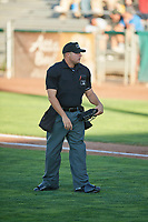 Umpire Colin Baron handles the calls behind the plate during the Pioneer League game between the Ogden Raptors and the Orem Owlz at Lindquist Field on June 27, 2017 in Ogden, Utah. (Stephen Smith/Four Seam Images)