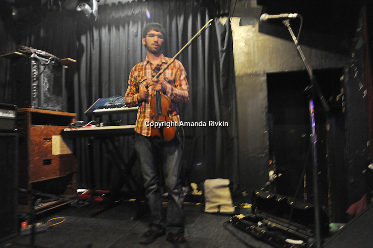 Pet Peeve violin, guitar, and vocalist Mark Adkison prepares before a live set at the Double Door in Chicago, Illinois on June 5, 2011.