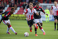 James Dayton of Cheltenham gets past Lewis Young of Crawley Town during the Sky Bet League 2 match between Cheltenham Town and Crawley Town at the LCI Rail Stadium, Cheltenham, England on 15 October 2016. Photo by Mark  Hawkins.
