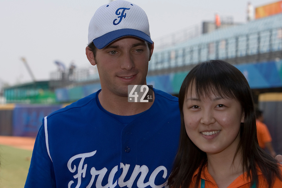 23 August 2007: #24 Gaspard Fessy poses with a journalist after the France 8-4 victory over Czech Republic in the Good Luck Beijing International baseball tournament (olympic test event) at the Wukesong Baseball Field in Beijing, China.