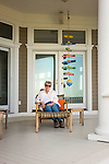 Woman on shorefront porch.