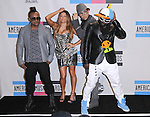 Apl.de.ap,Fergie,Taboo and Will.i.am of The Black Eyed Peas at The 2010 American Music  Awards held at Nokia Theatre L.A. Live in Los Angeles, California on November 21,2010                                                                   Copyright 2010  DVS / Hollywood Press Agency