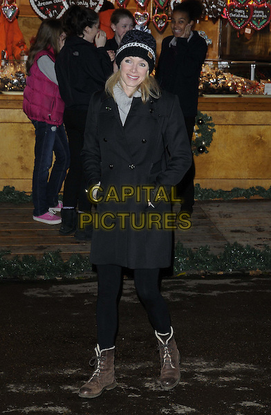 Nell McAndrew.at the Hyde Park Winter Wonderland launch party, Hyde Park, London, England, UK, November 22nd 2012..full length black coat tights hat hands in pockets ankle boots brown grey gray polo neck top  .CAP/CAN.©Can Nguyen/Capital Pictures.