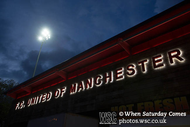 FC United of Manchester 0 Benfica 1, 29/05/2015. Broadhurst Park, Stadium Opening. Club signage on the main stand at Broadhurst Park, Manchester, the new home of FC United of Manchester, pictured after the club's match against Benfica, champions of Portugal, which marked the official opening of their new stadium. FC United Manchester were formed in 2005 by fans disillusioned by the takeover of Manchester United by the Glazer family from America. The club gained several promotions and played in National League North in the 2015-16 season, but lost this match 1-0. Photo by Colin McPherson.