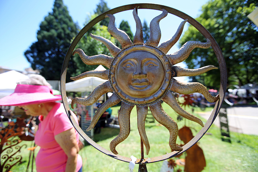 A natal sculpture depicting a sun for sale at the annual Recycled Art Fair in Esther Short Park in downtown Vancouver Sunday June 26, 2016. (Photo by Natalie Behring for the Columbian)