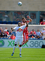 Chicago defender Gonzalo Segares (13) battles for a header with New York midfielder Dane Richards (19).  The Chicago Fire tied the New York Red Bulls 1-1 at Toyota Park in Bridgeview, IL on June 26, 2011.