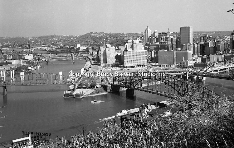 Pittsburgh PA:  View of the Three Rivers from Mt Washington. The construction of the Hilton Hotel and Fort Pitt Bridge and tunnels were in process and the Pittsburgh Bicentennial Gateway Amphitheater - was featuring a play of the city's history. The amphitheater was built to celebrate Pittsburgh's Bicentennial and to show a play highlighting the city's contributions to the nation.<br />