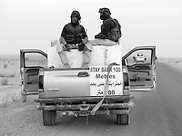 Private security operators from the British company ArmorGroup escort a supply convoy near Tal Afar, Iraq on October 19, 2006.  The coalition forces and civilian administration in Iraq depend heavily on thousands of controversial security contractors to support their reconstruction efforts and military operations.