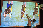 "Merrick, New York, USA. 11th June 2017.  ""American Grit"" contestant CHRIS EDOM (wearing white T-shirt), 48, of Merrick, hosts backyard Viewing Party for Season 2 premiere. Edom walked up to large screen and pointed to contestants hanging upside down over water in first edurance challenge, as his guests watched Episode 1 of FOX network reality television series broadcast that Sunday night outdoors."