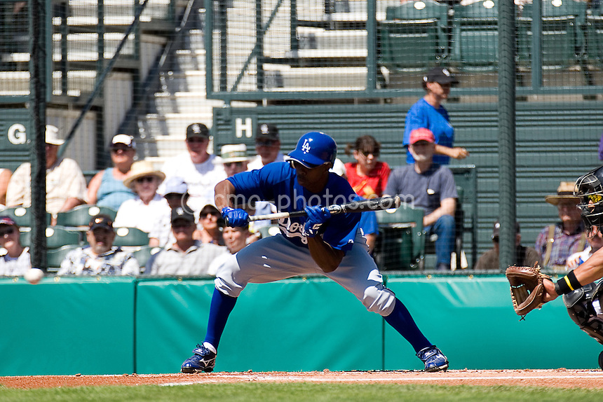 Mar 23, 2008; Tucson, AZ, USA; Los Angeles Dodgers left fielder Juan Pierre (9) attempts to bunt in the top of the 1st inning during a game against the Colorado Rockies at Hi Corbett Field. The Rockies beat the Dodgers 8-2.