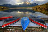 Boats lined up at Pyramid Lake outside Jasper, Alberta. Pyramid Mountain reflected in lake.