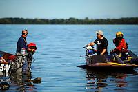 Kris Shepard (L) prepares a boat for racing.