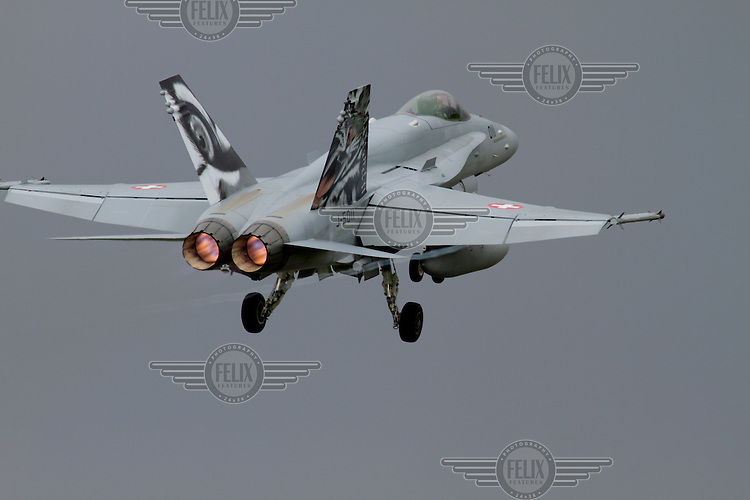 A Swiss F-18 Hornet takes off. Nato Tiger Meet is an annual gathering of squadrons using the tiger as their mascot. While originally mostly a social event it is now a full military exercise. Tiger Meet 2012 was held at the Norwegian air base Ørlandet.