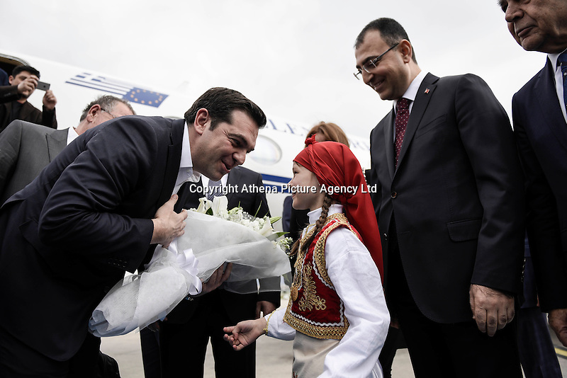 Pictured: Greek Prime Minister Alexis Tsipras is greeted by a young boy dressed in Greek traditional costume at the airport Tuesday 08 March 2016<br /> Re: The Prime Ministers of Turkey Ahmet Davutoglu and Greece Alexis Tsipras have met in Smyrna, Turkey to discuss ways to enhance their cooperation as both countries are grappling with an influx of migrants,